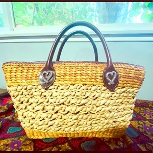 Brighton vintage straw bag with leather handle.
